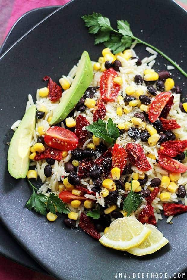 Southwestern Orzo Salad: Orzo Pasta mixed with sweet corn, black beans, tomatoes, avocado, and tossed with a simple and delicious Lemon Vinaigrette. This is really, reeeeeally good! Just what your 4th of July needs!!