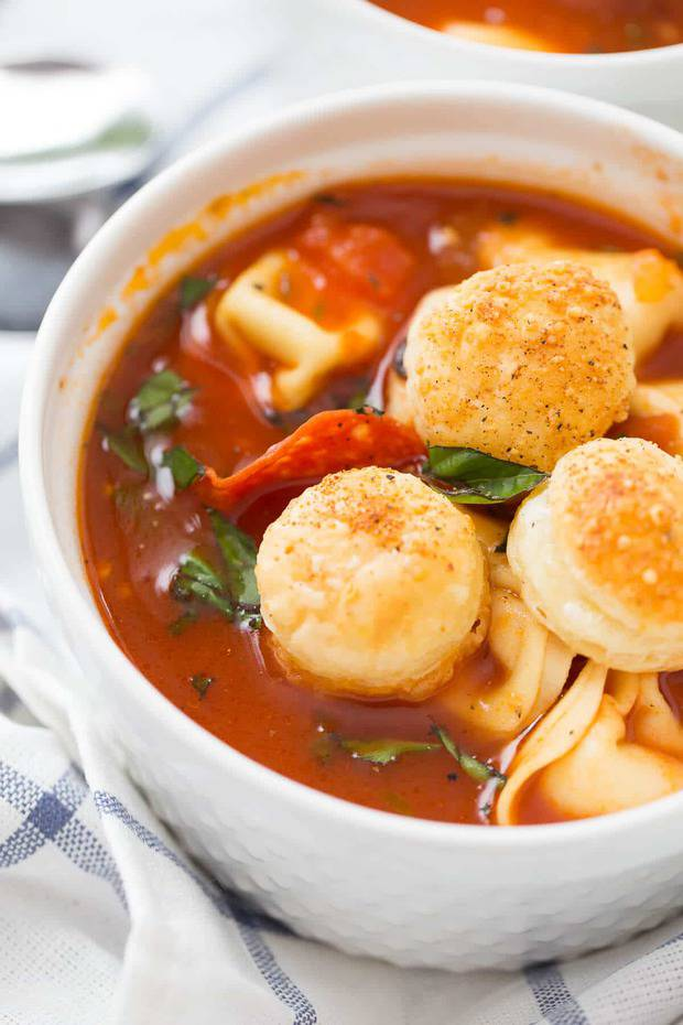 """This hearty pizza soup will be loved by adults and kids alike! This tomato-based soup is filled pizza favorites like Italian sausage, pepperoni,and spices. The toasted puff pastry croutons are like bits of """"crust"""" just floating on top!"""