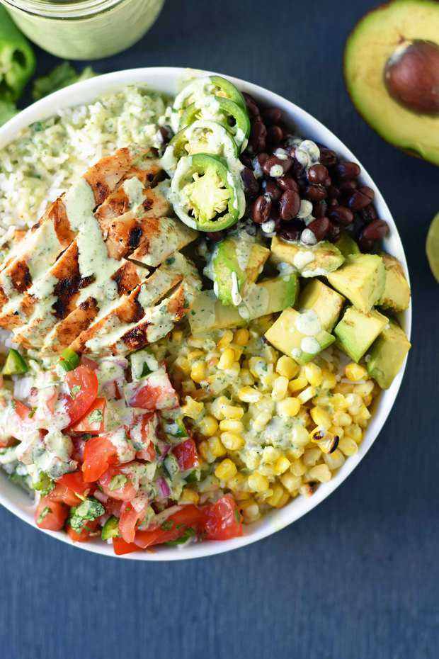 Grilled Chicken Burrito Bowls are all the rage. I think we can thank Chipotle for that. It's made with everything you stuff inside a burrito….without the large flour tortilla. It's basically the healthier version of the burrito. There is a reason that people can't get enough of protein bowls — you get a good amount of protein, healthy carbs, and vegetables. It's a filling, satisfying, flavorful meal.