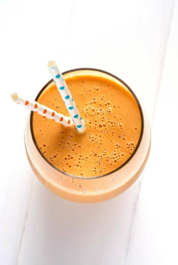 This healthy orange carrot smoothie is blended with pineapple, oatmeal and Greek yogurt for a protein and fiber filling breakfast