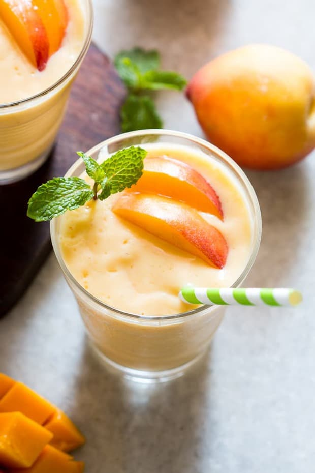 Super healthy peach mango smoothie is vegan and the frozen fruit makes it thick and dessert like!