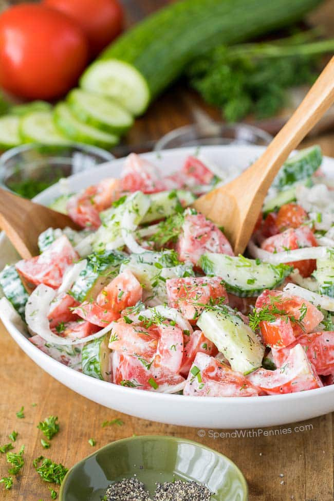 Creamy Cucumber Tomato Salad is the perfect side salad for any time of year! It is packed with juicy ripe tomatoes, crisp cucumbers and fresh herbs and all topped off with a delicious creamy dressing for a healthy addition to your menu plan