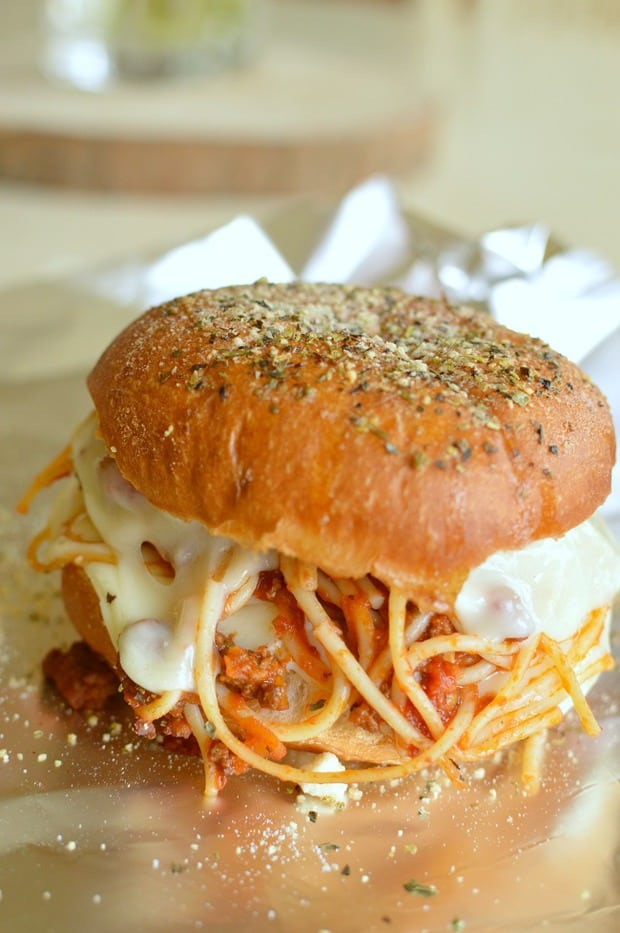 Easy Spaghetti Sliders is hearty spaghetti and garlic bread all wrapped up in one cheesy little slider! Make a few, or make a lot, either way they are super easy to make and are a hit with kids and adults alike! These quickly became on of my kids favorite meals and you are going to wonder what life was like before you knew these!e