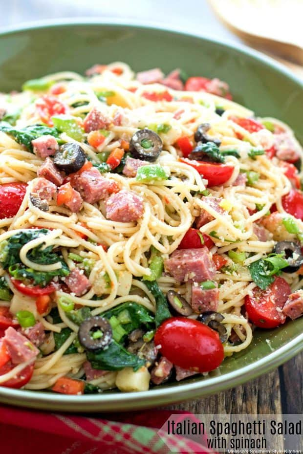 This Italian Spaghetti Salad with Spinach is packed with the Italian flavors we love. For this dish, al dente spaghetti noodles are tossed in a prepared Italian dressing with cubes of salami, mozzarella cheese, ripe olives, peppers, scallions and a sprinkle of Parmesan cheese. Toss in fresh baby spinach and it's practically a meal in itself.  This spaghetti salad is spectacular served warm, at room temperature or chilled making it ideal for entertaining or light meals.