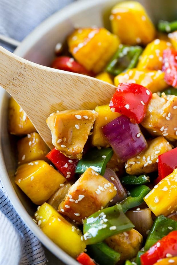 This Teriyaki Chicken Stir Fry from Dinner at the Zoo is full of tender chicken, colourful veggies, and fresh pineapple! It's all tossed in the most amazing sweet and savory homemade teriyaki sauce!