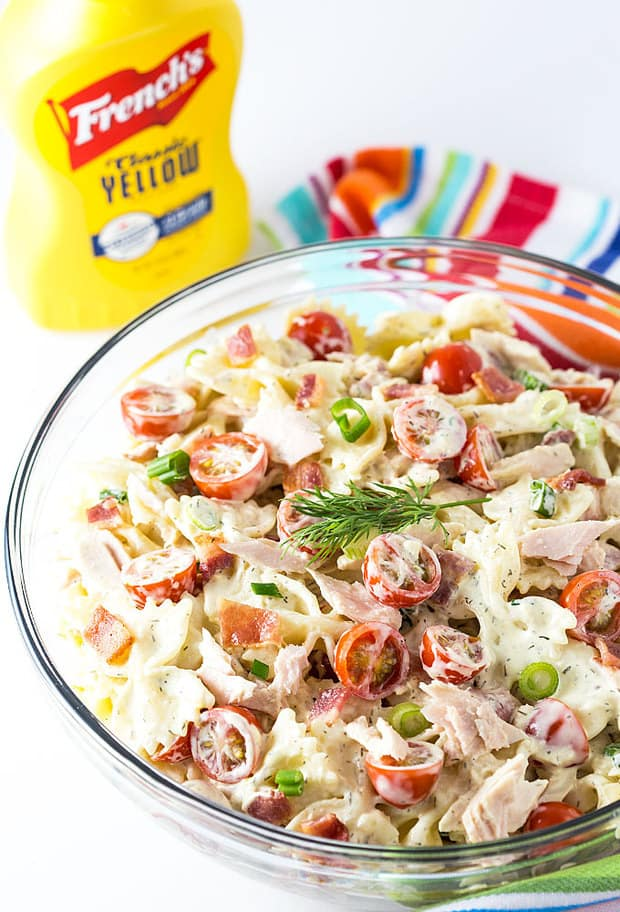 So hearty and packed full of flavor, you're going to love this easy Tuna and Bacon Pasta Salad!  Thank goodness spring has finally arrived and it's perfect picnic weather.  When I think of what to pack for an outdoor picnic, pasta salad always comes to mind every single time.