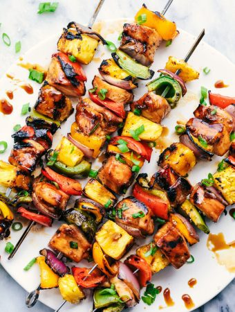 Grilled Hawaiian Teriyaki Chicken Skewers marinate in the very best homemade hawaiian teriyaki sauce! Loaded with peppers, fresh pineapple and red onions, these make an incredible and vibrant meal!
