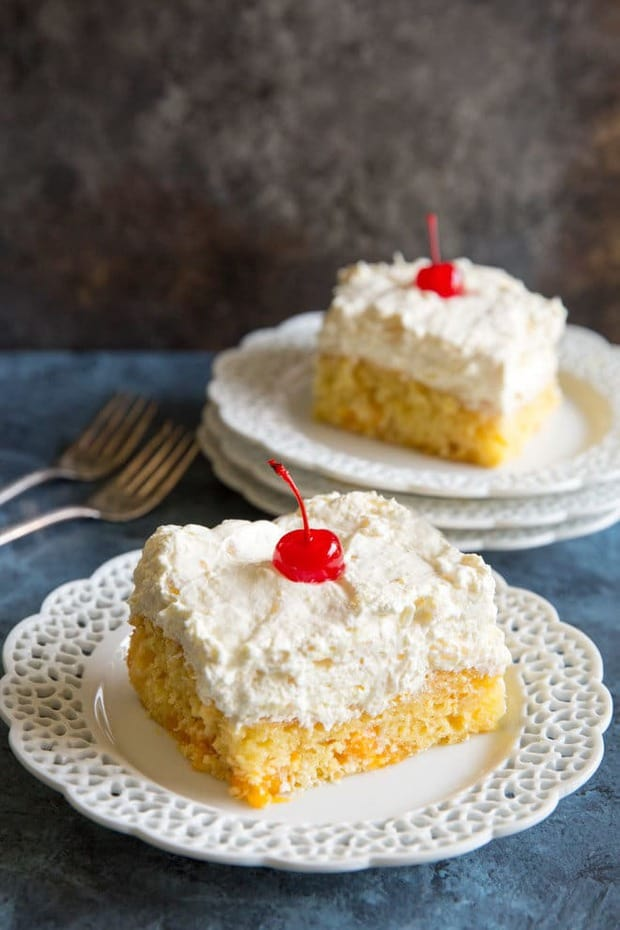 Hawaiian Wedding Cake has oranges in the batter, pineapple in the frosting, and is so easy to make! A fun tropical dessert you can enjoy year-round.