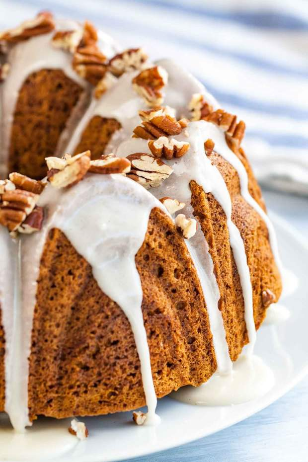 "Pumpkin Bundt Cake is super moist and topped with a maple glaze and toasted pecans! A perfect dessert for the holidays that ""wow's"" and is easy enough to make even if you aren't totally kitchen confident."