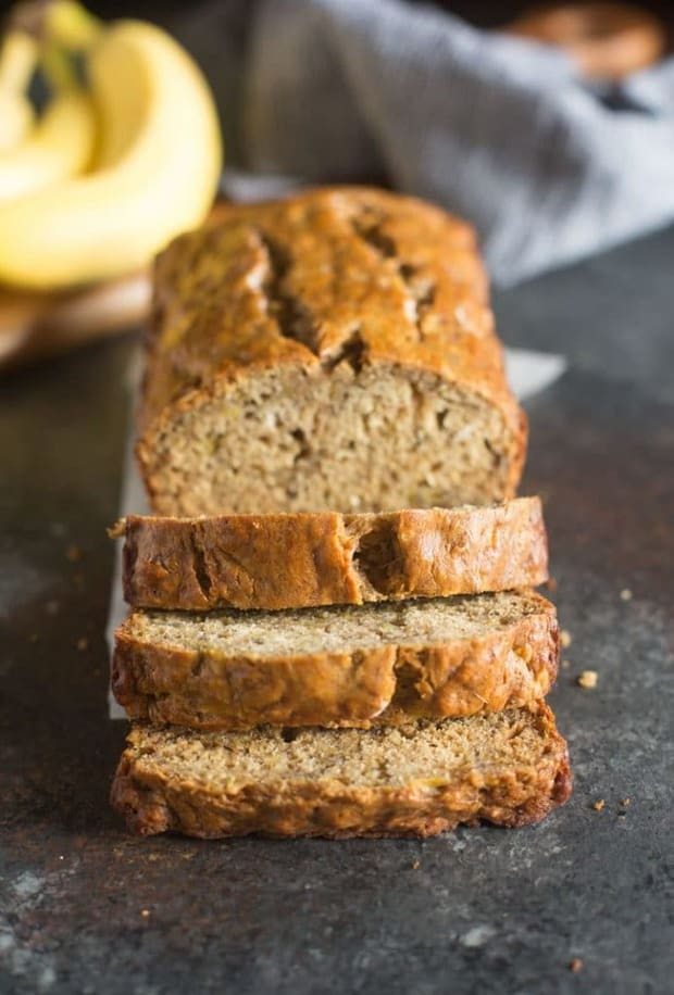 My favorite Skinny Banana Bread recipe has no oil, is low sugar, and just over 100 calories/slice! It's the BEST healthy banana bread recipe to still yield incredibly moist, perfectly sweet, and delicious bread!