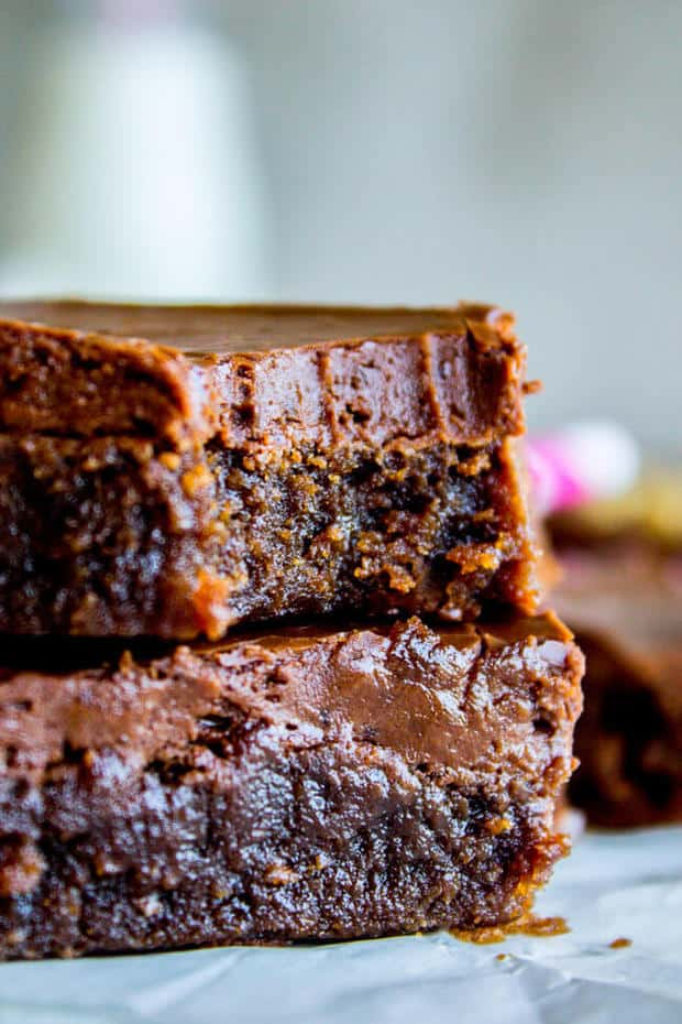 Nana's Famous Fudge Brownies are the most decadent fudge brownies with chocolate fudge frosting you will ever eat! These brownies are thick and chewy and not cakey in any way shape or form.