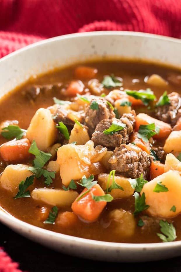 Best Ever Instant Pot Beef Stew – This mouthwatering and easy to make Instant Pot Beef Stew is sure to become one of your favorite ever Instant Pot recipes!  Tender beef is simmered in a super flavorful and hearty broth that's packed with veggies!