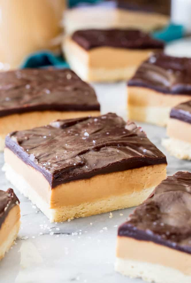 Peanut Butter Shortbread Bars are similar to Millionaire's shortbread, only with a rich fudgy peanut butter filling instead of caramel! Made with a buttery shortbread-style crust and crowned with a rich dark chocolate ganache (and a sprinkle of sea salt), these are totally addictive treats.