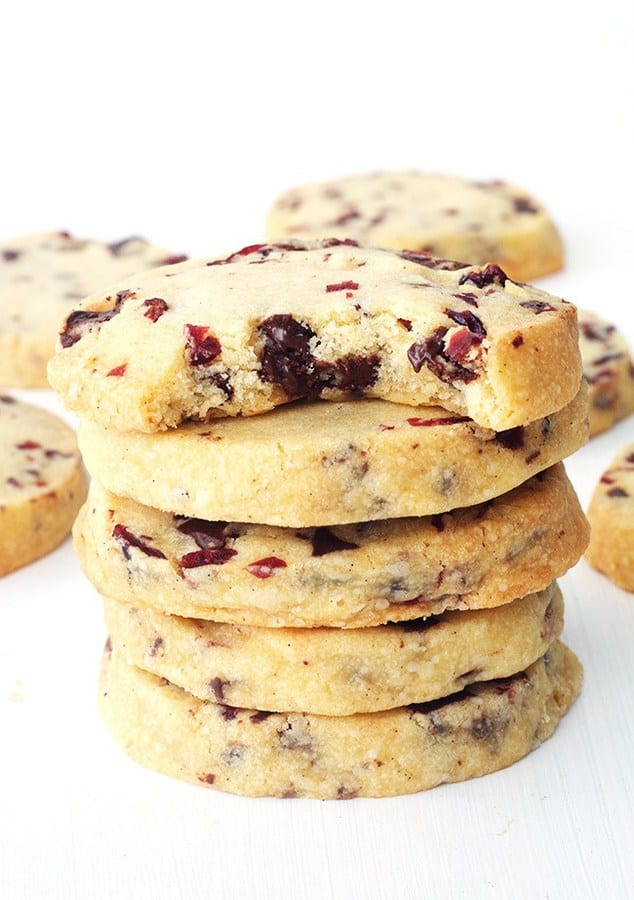 Buttery melt-in-your-mouth Dark Chocolate Cranberry Shortbread Cookies! These chunky biscuits can be made with only a handful of ingredients and will satisfy any cookie craving.