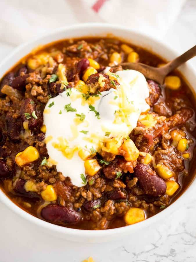 nstant Pot Chili that is so easy to make! This pressure cooker chili with canned beans warms up any occasion, from Game Day parties to family meals. Cooking chili at high pressure makes it so flavorful and is the quickest way to get dinner on the table!