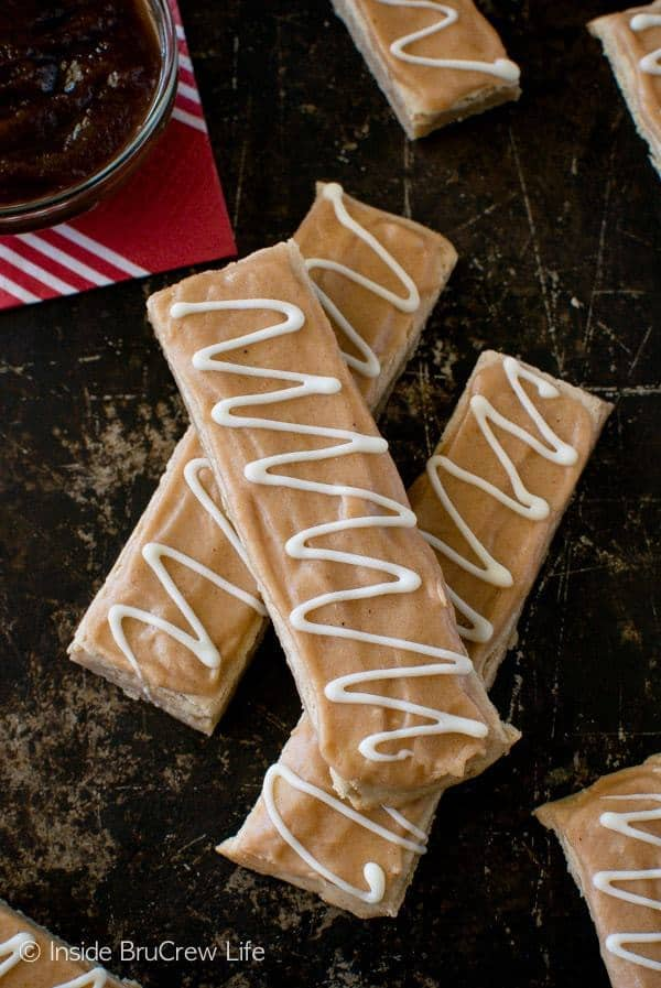 A sweet frosting and a white chocolate swirl give these Glazed Apple Butter Shortbread Bars a fun fall flair. These are a great cookie to enjoy with a cup of hot or cold apple cider.