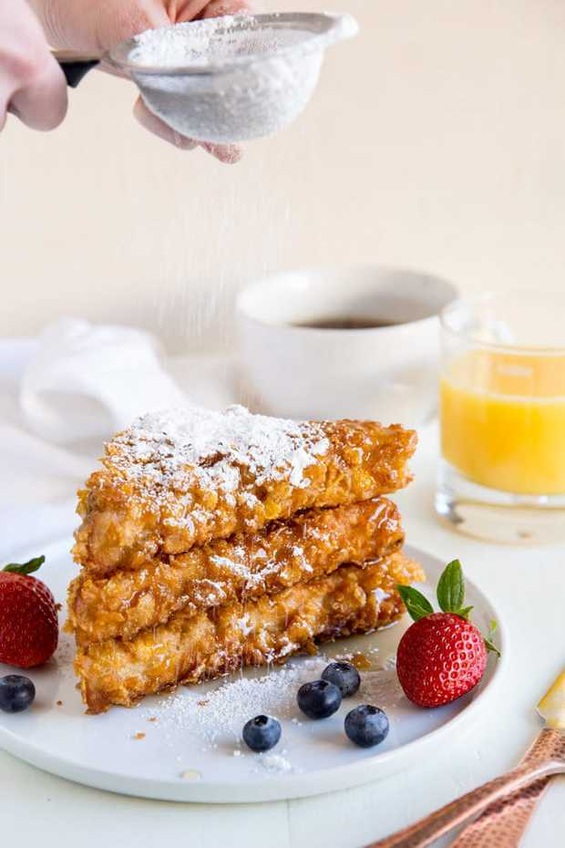 Cornflake Crusted French Toast! Texas toast dipped in extra thick cinnamon batter and crusted with cornflakes. That extra crunch is unbelievably addictive!