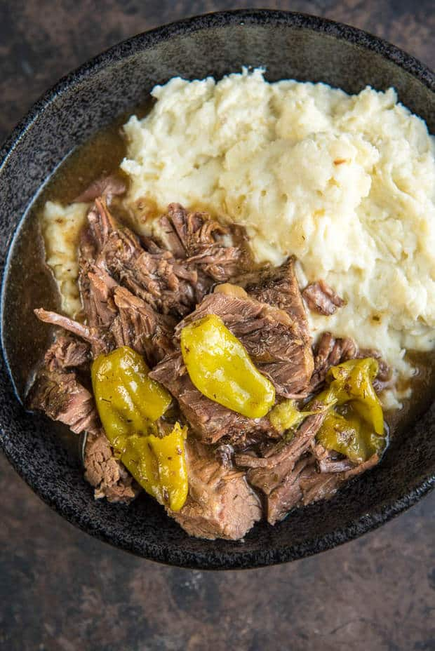 This Slow Cooker Mississippi Pot Roast from Slow Cooker Gourmet is a simple way to take your dinner from average to amazing! Mezzetta pepperoncini peppers give it a tasty flavor twist!