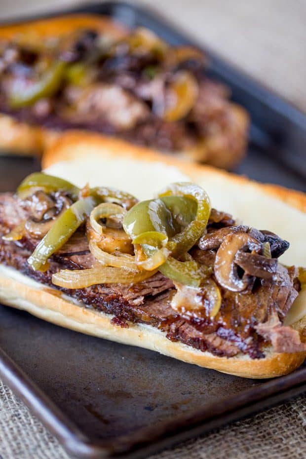 TheseSlow Cooker Philly Cheese Steak SandwichesfromDinner Then Dessertare so tender and full of flavor, you'll feel like you're in Philly! They are perfect for feeding a crowd or a hungry family!
