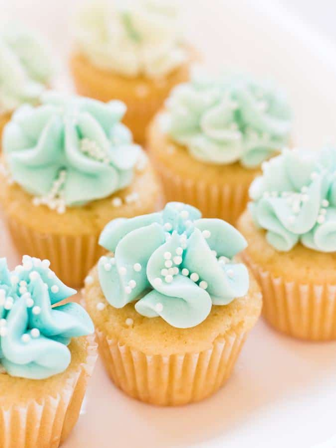 Mermaid cupcakes look like they could be served under the sea with ombre blue frosting. This recipe for vanilla cupcakes and buttercream frosting uses blue dye to create cupcakes fit for a mermaid!