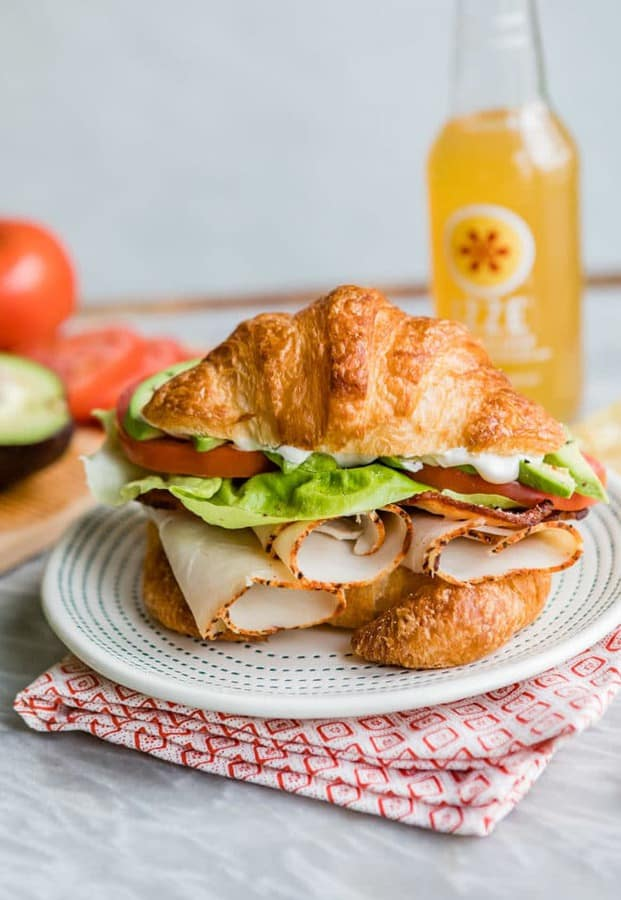 An easy recipe for a Turkey Avocado BLT Croissant Sandwich. Make this delicious Red Robin copycat at home with flaky, buttery croissants, lots of bacon, juicy tomatoes, and as much avocado as you want!