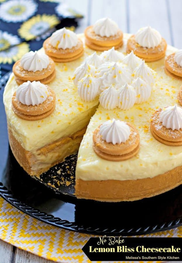 This No Bake Lemon Bliss Cheesecake from Melissa's Southern Style Kitchen is for all the lemon lovers in your life. A crushed lemon creme cookie crust is filled with a luscious lemon cheesecake and more cookies!