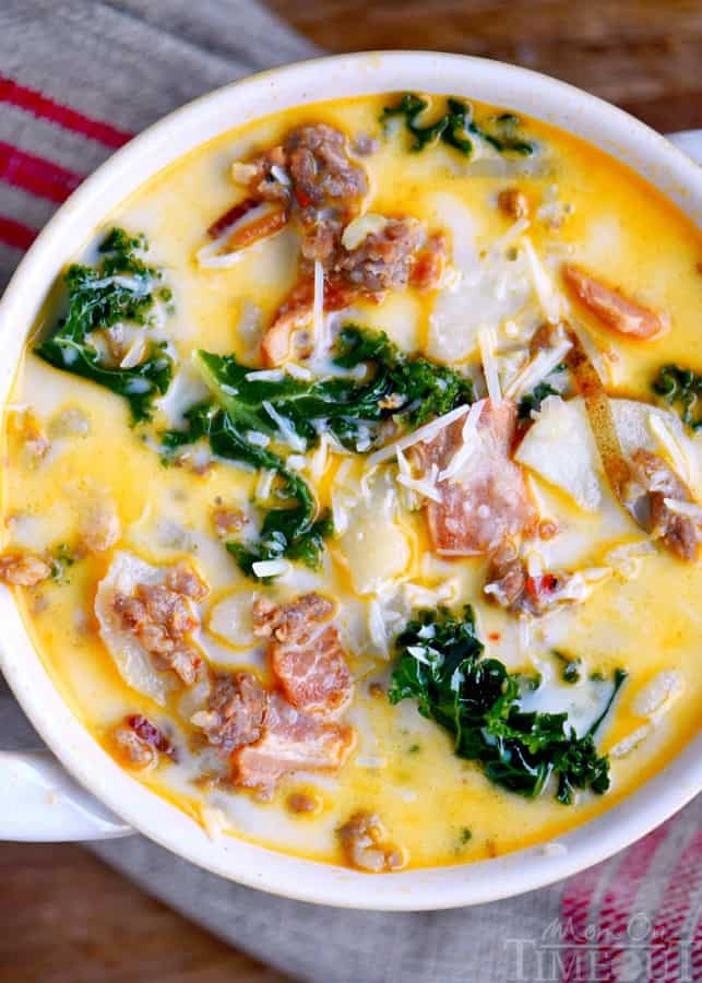 The whole family will love this copycatOne Pot Olive Garden Zuppa Toscana Soup! Comfort food at it's best! Loaded with bacon, sausage, potatoes, and kale! So delicious and filling!