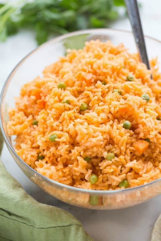 The BEST, truly authentic Mexican rice! Super easy to make from home, and a necessary side dish for all of your favorite Mexican recipes.