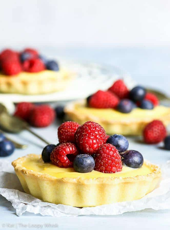 These gluten free berry tartlets are everything bright and happy and summery. With a buttery gluten free sweet shortcrust pastry and a decadent lemon-flavoured cream filling, they are the perfect treat for any occasion. Super easy to make, these mini tarts are the perfect gluten free dessert!