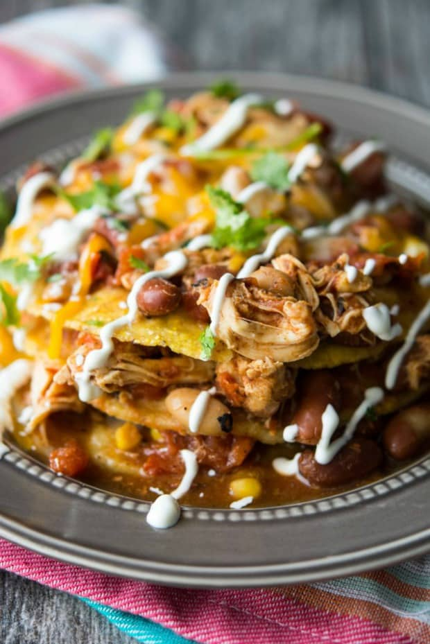 A delicious Mexican inspired Chicken Chili that slow cooks all day, then using that chili to drizzle all over some crispy corn tortillas, and finally topping it all off with massive amounts of cheese and sour cream?