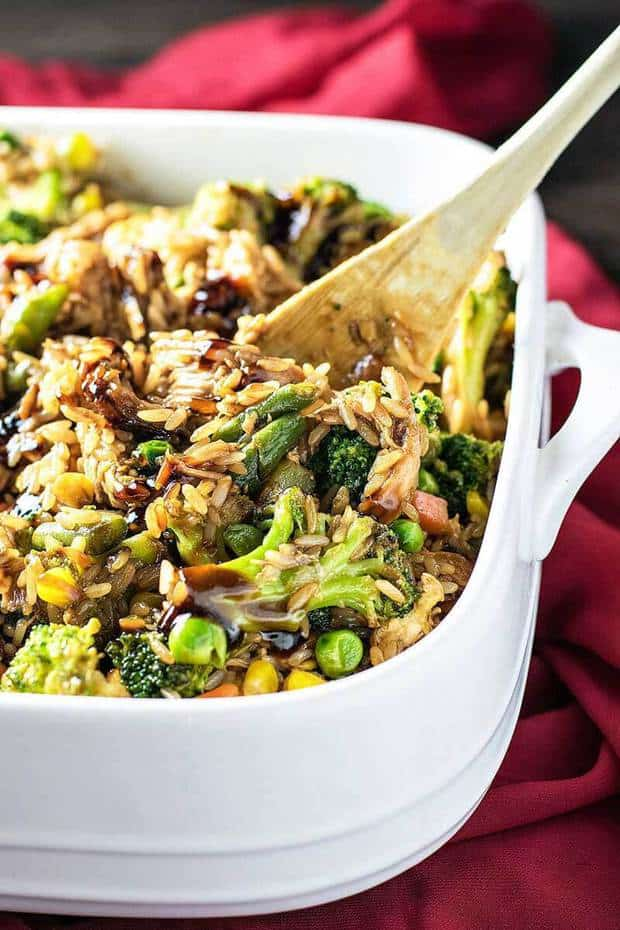Have your favorite Chinese takeout prepared in a different way: baked in a casserole dish with assorted veggies and fried rice.