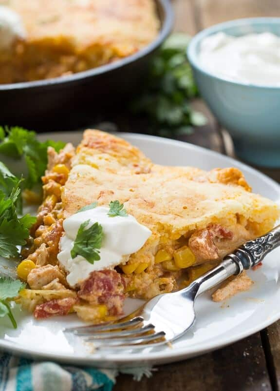 This Mexican Chicken Cornbread Casserole has a creamy chicken filling and a cheesy cornbread top. It makes a wonderful weeknight meal and can be made start to finish in 30 minutes.
