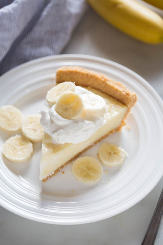 Homemade Banana Cream Pie with no box-pudding mix. A delicious homemade custard filling that holds together perfectly, layered inside a nilla wafer crust.