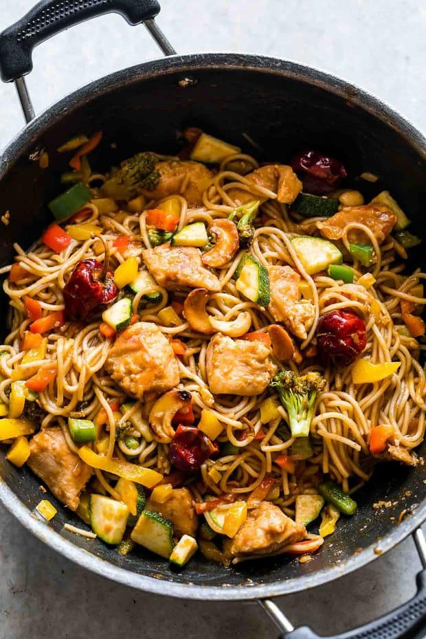 Chinese Cashew Chicken Noodles Stir-Fry is a delicious take on your favourite take-out cashew chicken recipe. Crispy bits of chicken and noodles are tossed in a super flavourful, spicy sauce and roasted cashews for a meal that the whole family will love!