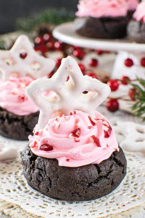 Fluffy pink filling and a fun peppermint pretzel makes these prettyChocolate Peppermint Fluff Cookie Cupsthe star of any holiday party!
