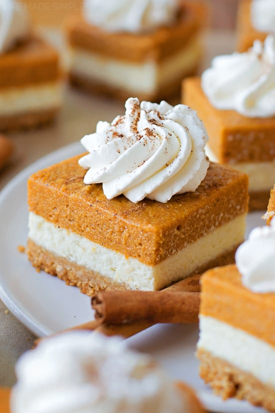You're going to love these layered pumpkin pie cheesecake bars. They've got a graham cracker crust, a layer of cheesecake and a layer of pumpkin pie on top