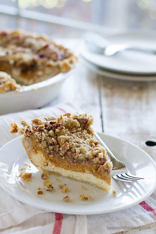 Cheesecake and pumpkin pie combined! A cheesecake layer is topped with a pumpkin pie layer and then a layer of streusel in this holiday worthy Pumpkin Cheesecake Pie.