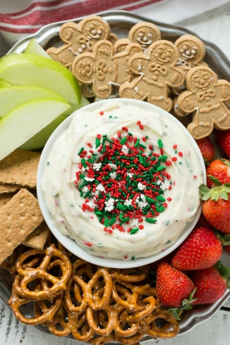 T This Christmas Cookie Dough Dip has a creamy and fluffy eggless sugar cookie base swirled with holiday sprinkles for a fun and festive appetizer or dessert.