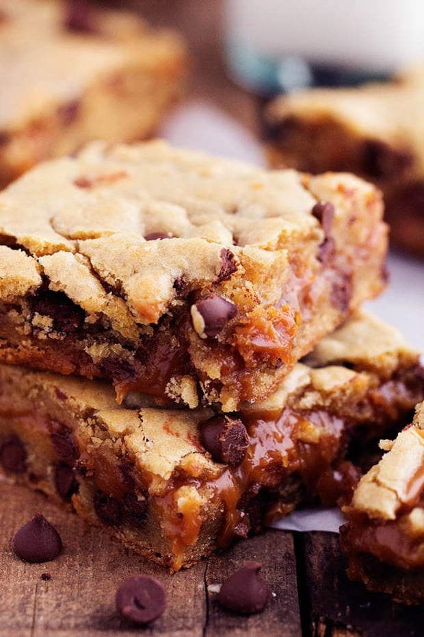 Perfectly chewy chocolate chip cookie bars with an ooey gooey peanut butter caramel center.  These will be one of the best treats that you make!