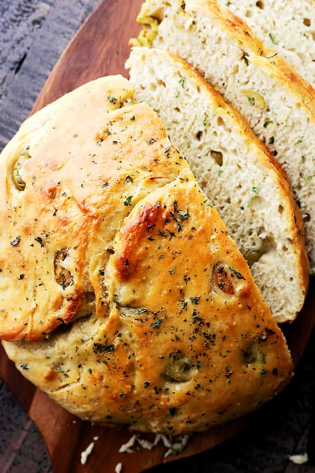 Very easy to make, no-knead, crusty and delicious bread packed with marinated olives and garlic.
