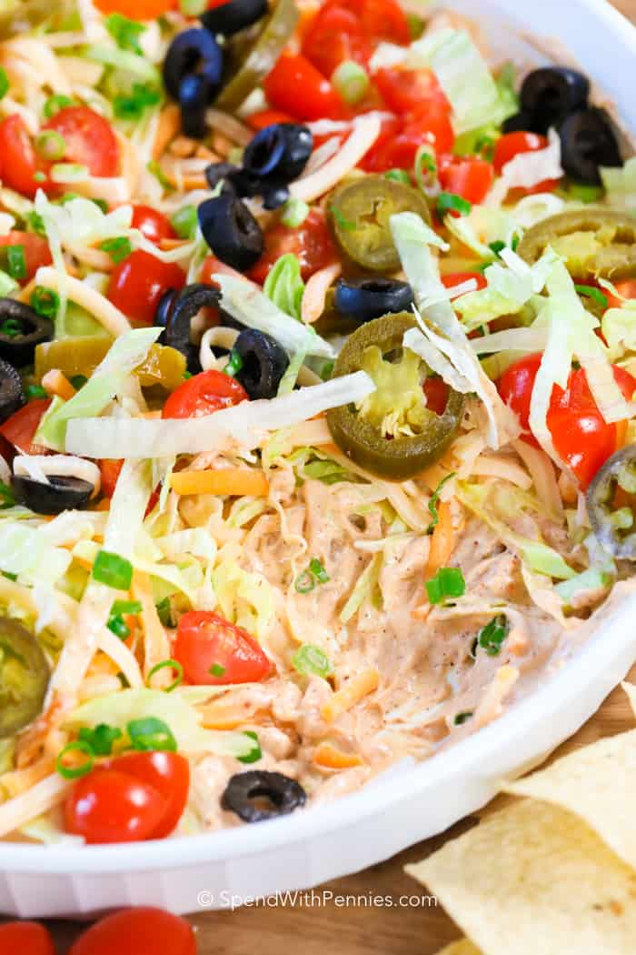 Taco dip is the perfect snack to make for game day, dinner parties, potlucks, Mexican night, you name it!