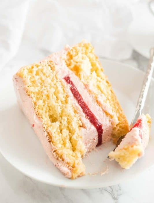 This Homemade Strawberry Cake from Plated Cravings is every strawberry lovers dream! Made with a fluffy European sponge cake that only needs 5 ingredients and is made without butter or oil yet is so airy and delicious.