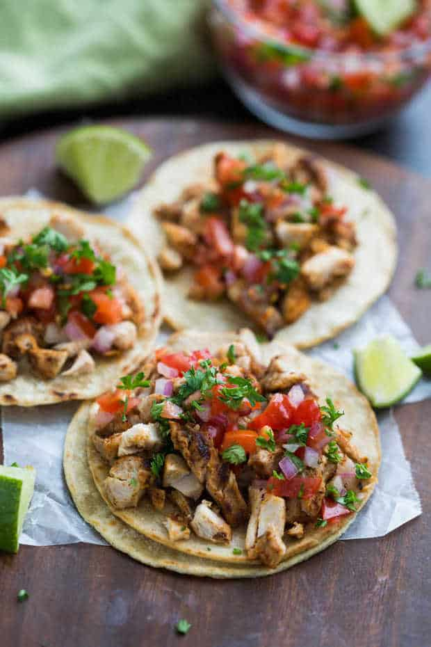 My family goes crazy for thesegrilledchicken tacos, and I love how EASY they are to make! Marinated chicken thighs are grilled to perfection and servedwith warmed corn tortillas, pico de gallo, and cilantro.