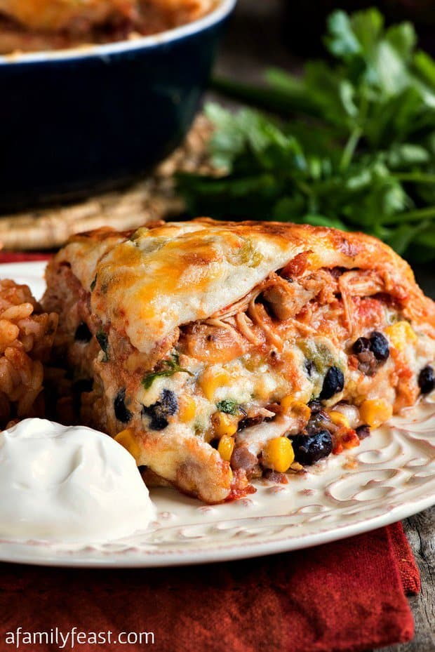 This easy, creamy, cheesy Mexican Lasagna with White Sauce uses our pulled chicken recipe as part of the filling (which – by the way –  is one of the most popular recipes on our site).
