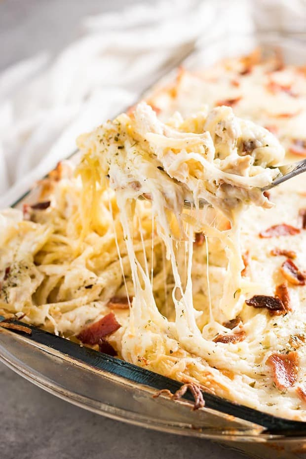 This Million Dollar Chicken Spaghetti from The Salty Marshmallow is the best ever chicken spaghetti that is easy to make! This mouthwatering chicken spaghetti casserole is rich and hearty, full of cream cheese, bacon, sour cream, parmesan, mozzarella, tender chicken, and spaghetti noodles baked to perfection!