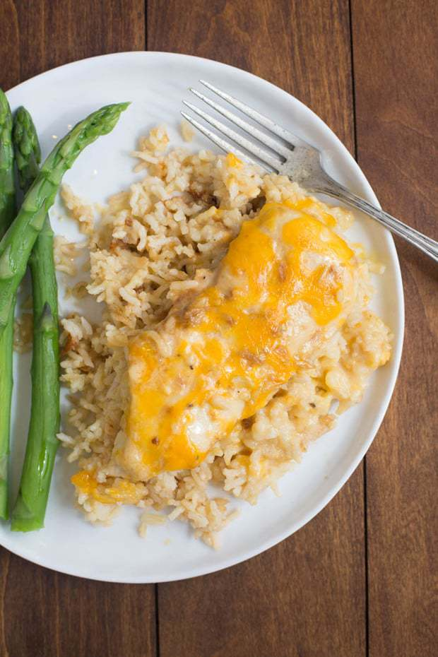 My family loves this easy One Pan Cheesy Chicken and Rice casserole. Just a few short minutes to throw together and let the oven do the rest.