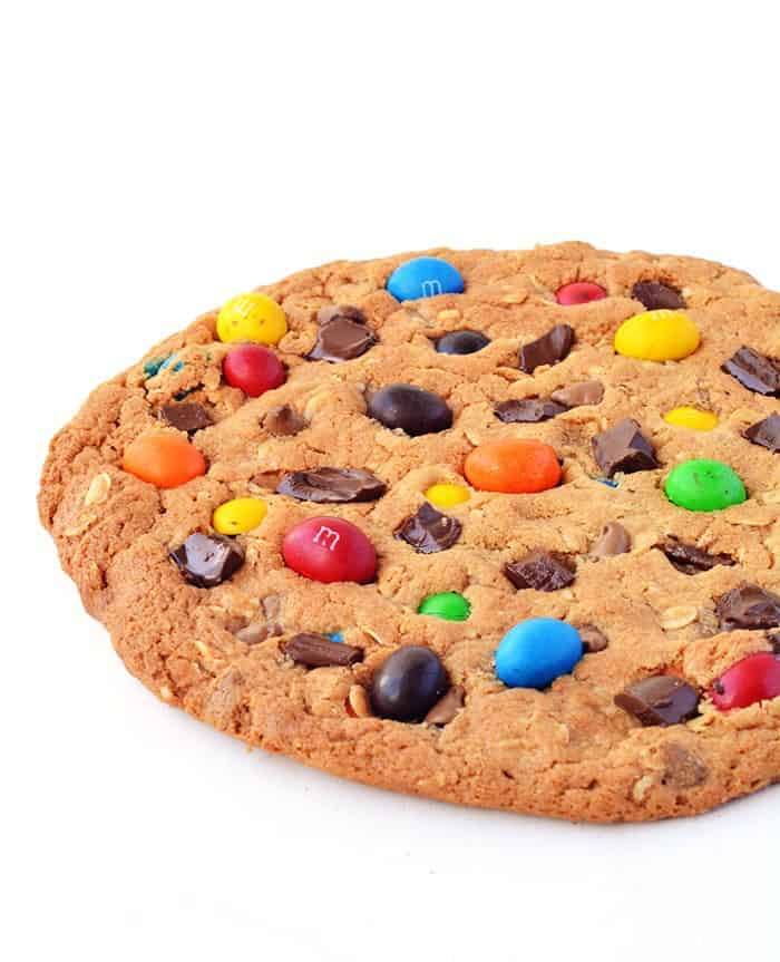 One Giant M&M Monster Cookie filled with chewy rolled oats, peanut butter, crunchy M&M's and a boatload of chocolate chips!