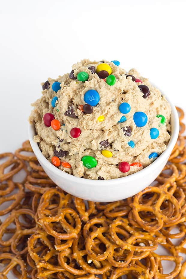 This monster cookie dough dip is inspired by the monster cookie and whipped until light and airy. It's loaded with peanut butter, oatmeal, candies, chocolate chips. Serve with pretzels for a sweet and salty taste!