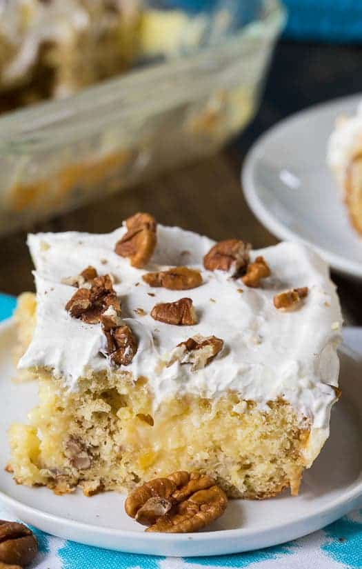 Hummingbird Cake, with its moist texture and flavoring from pecans, pineapple, and banana, is one of my favorite southern cakes. Usually I make a traditional-style  Hummingbird Layer Cake with Cream Cheese Icing, but I was in the mood to make a poke cake, Hummingbird style.