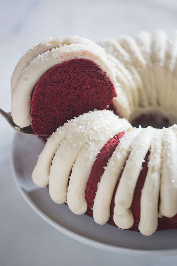 Moist and tender Red Velvet Bundt Cake with cream cheese frosting. Add some chocolate chips for a an even more delicious chocolate flavor.